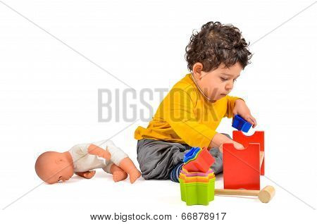 Boy And Didactic Toys