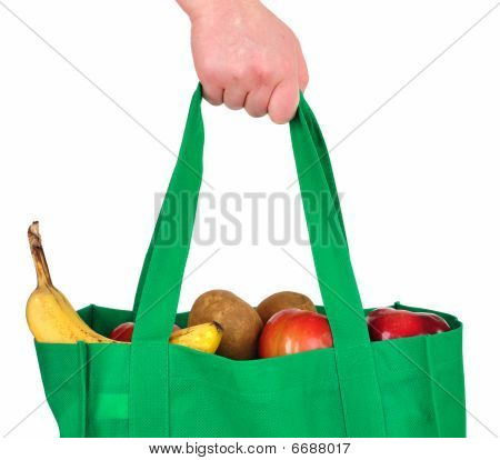 Carrying Groceries In Reusable Green Bag
