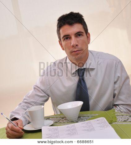 Latin Businessman Eating Thinking