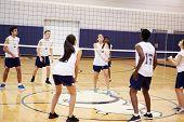 High School Volleyball Match In Gymnasium poster