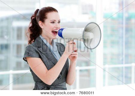 Self-assured Businesswoman Yelling Through A Megaphone
