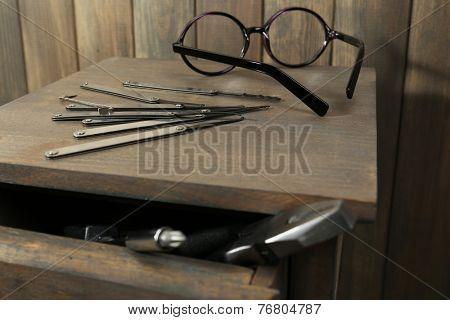 Lock picks on wooden table