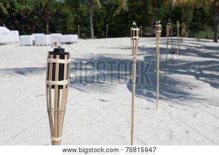 Tiki Torches On The Beach