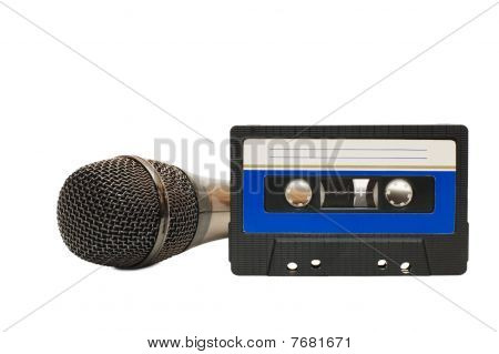 Audiocassette And Microphone Isolated On White Background