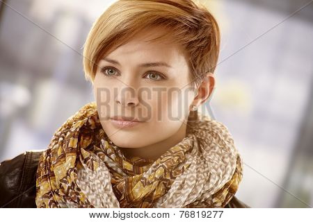 Closeup portrait of young woman in scarf on a spring day