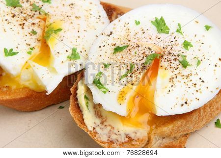 Poached eggs on toasted baguette slices.