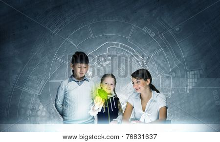 Young teacher and school children at botany lesson