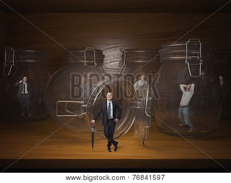 3d glass jail and business people prisoners