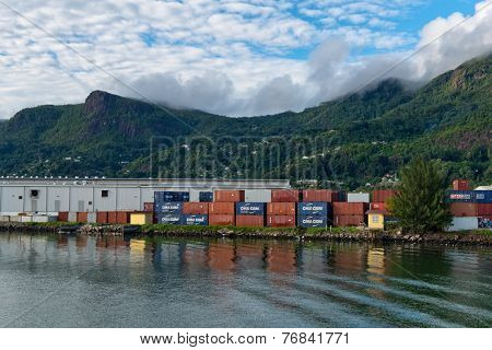MAHE, SEYCHELLES - 21 OCTOBER 2014 - Cargo Containers Stacked Waterside at Victoria Harbor, Seychelles on 21 October 2014
