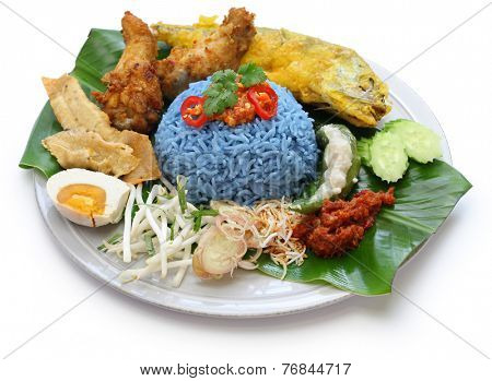 nasi kerabu, blue color rice salad, traditional malaysian cuisine isolated on white background