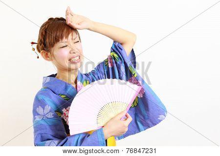 woman suffers from intense heat