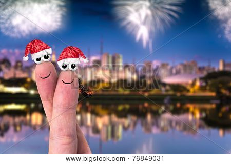 Cute couple finger in christmas theme on the city