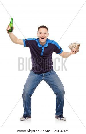 Sport fan with beer bottle and popcorn in his hands