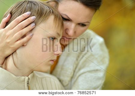 Sad mother with a son