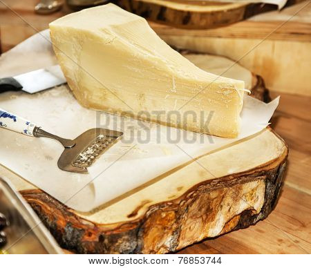 Parmesan Cheese On A Wooden Plate