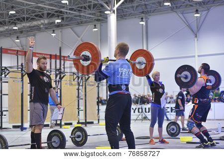 NOVOSIBIRSK, RUSSIA - NOVEMBER 16, 2014: Unidentified athletes during the International crossfit competition Siberian Showdown. The competition included in the program of the festival Siberian Health.