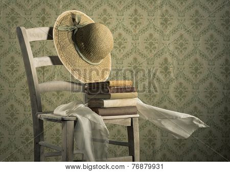 Old Books On A Chair With Straw Hat