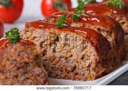 Meatloaf With Ketchup On A Background Of Ripe Tomatoes