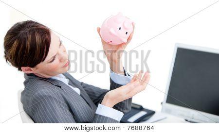 Upset Businesswoman Holding A Piggy-bank