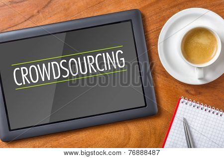Tablet on a wooden desk - Crowdsourcing
