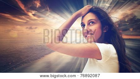 Close up Smiling Young Woman Wearing White Shirt, Posing with One Hand on the Forehead, on Sunset at the Sea Background with Abstract Illuminating Light.