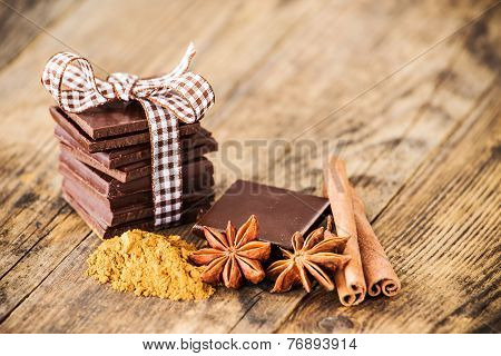 Chocolate wood table surrounded by spices.