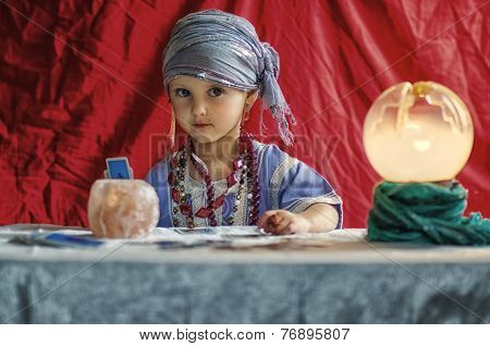 little child plays to be a fortune teller poster
