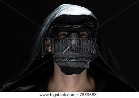 Portrait of madman in handmade mask