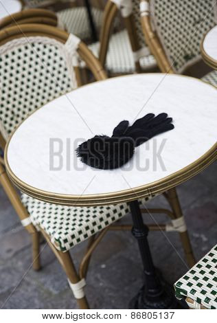 Forgotten Female Glove on a cafe table in Paris