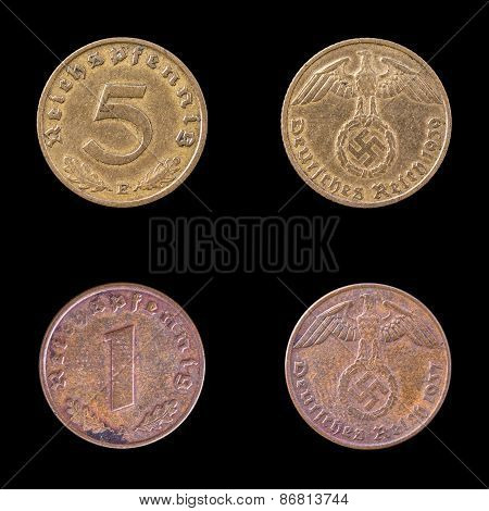 Two Fascist coins on a Black Background.