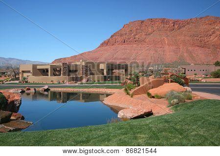 Pueblo style housing against mountain