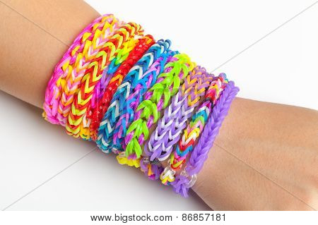 Colorful rubber rainbow loom band bracelets on hand trendy kids fashion accessories poster