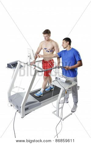 Sports Scientist Doing Performance Assessment On Treadmill. Modern Technology.