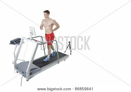 Sportsman Doing Performance Assessment With Treadmill And High Speed Camera. Modern Technology.