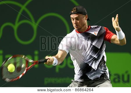 KEY BISCAYNE, FL-MAR 26: Lleyton Hewitt of Australia returns a shot during day four of the Miami Open at Crandon Park Tennis Center on March 26, 2015 in Key Biscayne, Florida