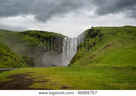 Beautiful and dramatic Skogafoss waterfalls in Iceland poster