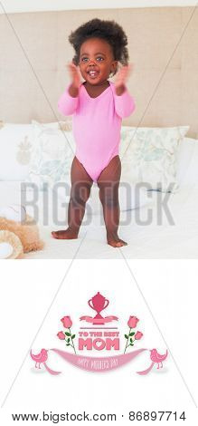 mothers day greeting against baby girl in pink babygro standing on bed