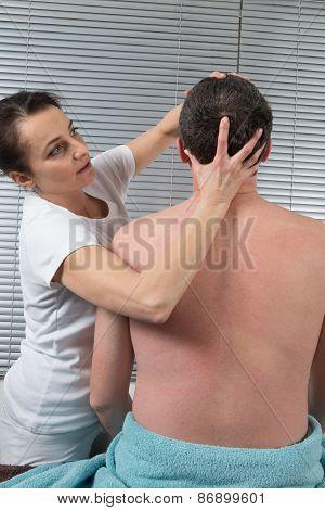 A Man Receiving Shiatsu Treatment