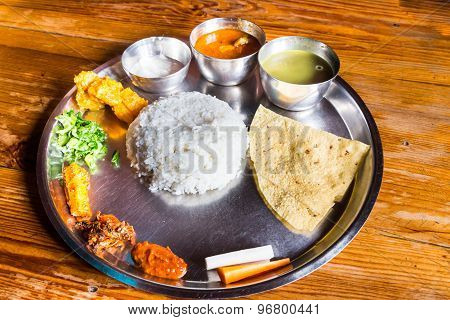 Delicious Nepali Thali meal set with chicken curry poster