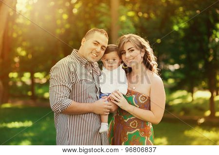 Father, Mother And Little Son Playing Outside In Summer