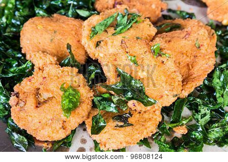 Masala Vadai with curry leafs, a popular Southern Indian deep fried snack