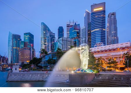Singapore Skyline And Merlion At Twilight