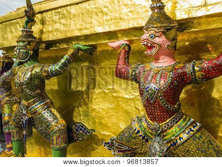 Perspective view of demon guardians supporting Wat Arun Temple, Bangkok, Thailand poster