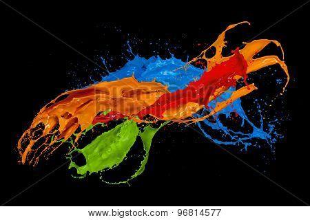 Colored paint splash isolated on black background