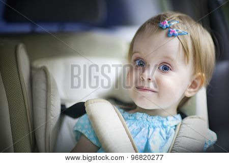 Happy Little Baby Girl In The Car Seat