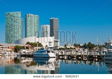 View of the Marina in Miami Bayside with modern buildings and skyline in the background. poster