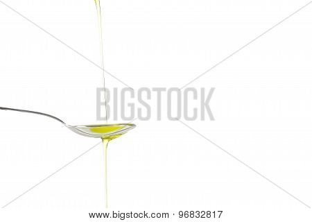Olive oil into a spoon