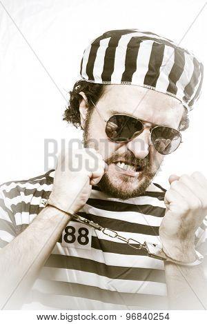 Lawbreaker, Desperate, portrait of a man prisoner in prison garb, over white background