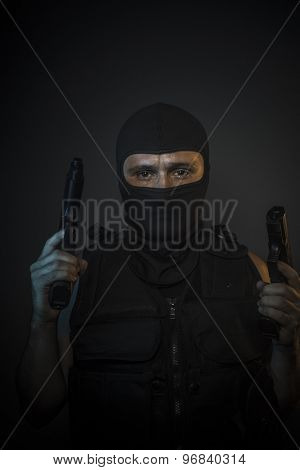 Criminal, Man wearing balaclavas and bulletproof vest with firearms poster