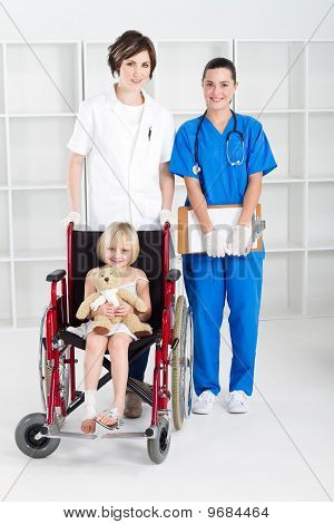 nurse, doctor and little girl in wheelchair